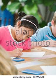 students doing math work in classroom stock photo royalty free
