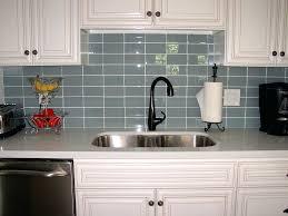 tile backsplash ideas with black granite countertops ocean glass