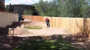 pro mountain biker ross schnell on his backyard pump track youtube
