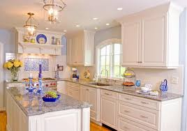 stylish white kitchen in a large space with glossy cabinetry and