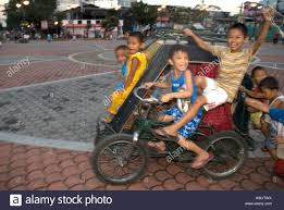 philippines pedicab philippines manila malate kids with pedicab stock photo royalty