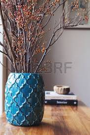 Vase With Twigs Close Up Of Teal Moroccan Vase With Sticks And Background Decor