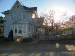 village living with a backyard in the country for sale by