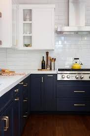 white kitchen cabinets with blue subway tile navy blue cabinets with brass hardware white subway tile
