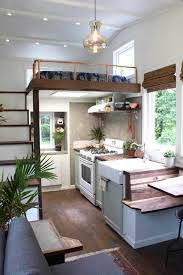 a pretty little tiny house on wheels built as part of