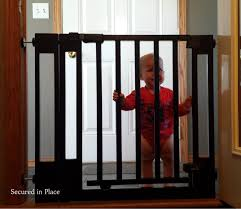 secure top of the stairs walk thru baby gate momma in flip flops