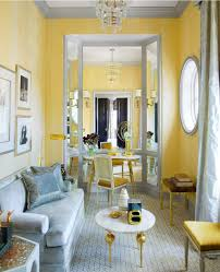 ashley wittaker living room in blue and yellow interiors by color
