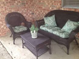 hand me down white plastic wicker patio furniture spray painted espresso cushions from pier plant from home depot plant pot from target