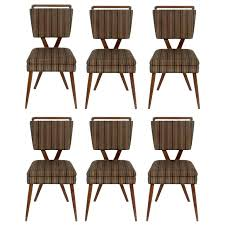 dining chairs with arms australia and casters chair seat covers