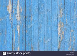 blue peeling painted wood planks as background or texture