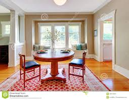 beautiful decor of dining room with beige blue and red stock