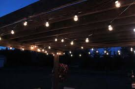 How To String Patio Lights Creative Juices Decor Adding String Patio Lights To The Pergola
