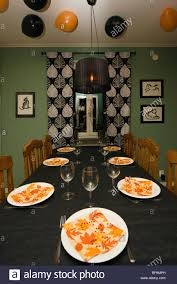 a table set up for a halloween dinner party in the ceiling there