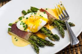 cuisine hollandaise prosciutto wrapped asparagus with poached egg and hollandaise sauce