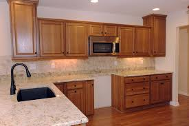walnut island with granite top dark cabinets color schemes