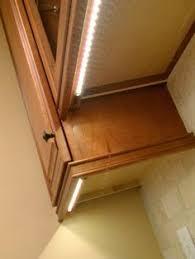 Light Under Cabinet Kitchen by Electrical Outlet Tucked Under Cabinet Home Design Pinterest
