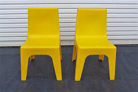 Molded Plastic Outdoor Chairs by 2 Yellow Stacking Childs Chairs Polyziv Israel Mod Space Age