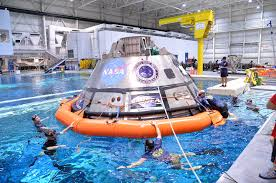 divers practice orion recovery techniques in giant pool at jsc nasa