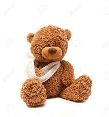 isolated teddy bear with a broken arm stock photo picture and