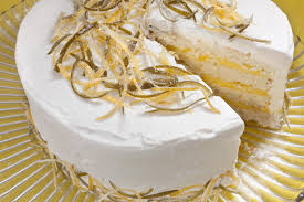 white cake with lemon lime curd filling and whipped cream frosting