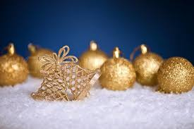 gold christmas gold christmas tree decorations in snow on blue background stock