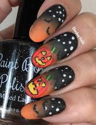 ehmkay nails halloween nail art glowing pumpkin nail art at the