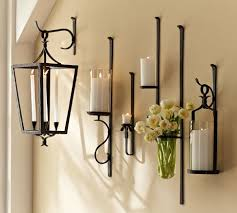 artisanal wall mount candle holders by pottery barn the