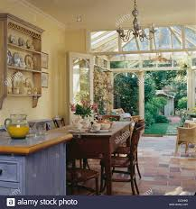 Open Kitchen Dining Room by Simple Wooden Table And Chairs In Country Kitchen Dining Room With