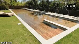 coooool wooden deck sinks to reveal hidden pool geekologie