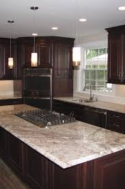 black kitchen cabinets with white subway tile backsplash cabinets with white granite countertops countertopsnews