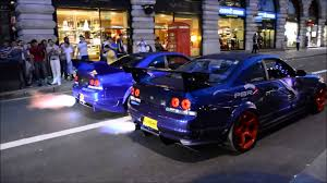 Nissan Gtr R33 - two nissan gtr r33 skylines revving and shooting flames in london