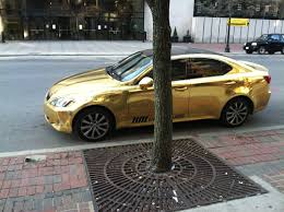 lexus symbol meaning gold painted lexus with a diamond covered emblem