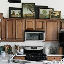 what to put on top of kitchen cabinets for decoration 9 ways to decorate above your kitchen cabinets