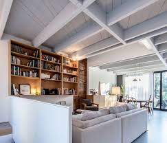 smart extension of a twin rooftop in montreal thomas balaban view in gallery living area of the duplex home draped in neutral hues