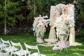 wedding ceremony arch wedding arch decorated with cloth and flowers outdoors beautiful
