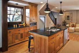 oak kitchen cabinet with black concrete countertop floor to