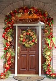 admirable black wooden entrance door combined green wreath with