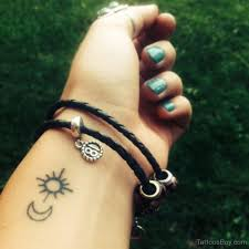 small sun and moon on wrist designs pictures
