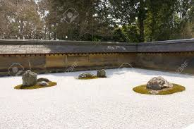 Japan Rock Garden by Rock Garden Kare Sansui In Ryoan Ji Temple Kyoto Japan Stock