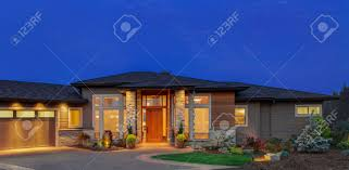 home exterior at night beautiful ranch style home with deep