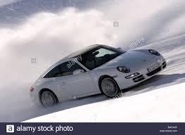 porsche 911 targa white porsche 911 targa 4s model year 2006 white driving diagonal