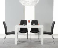 stainless steel based leg dining table using white acrylic round