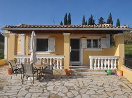 yellow wall greek home plans with white fence can add the modern