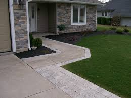 Covering Old Concrete Patio by Widening The Driveway And Walkway With Paver Stones Instead Of