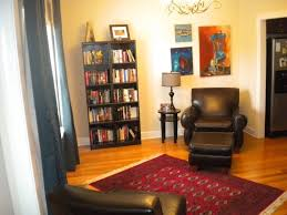 Best Chairs For Reading Great Looking Reading Room With Black Bookshelf And Red Floral Rug