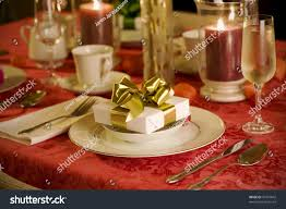 Gold Table Setting by Elegant Christmas Table Setting In Red With Gold Gift As Focal
