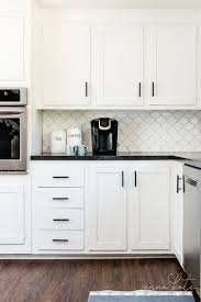 what hardware looks best on black cabinets kitchen hardware trends 2021 kate at home