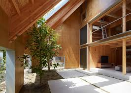 suppose design office hides garden beneath roof of house in anjo