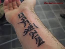 black tibetan script on forearm