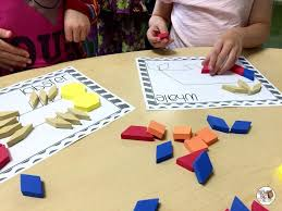learn 2d and 3d shapes guided math and math centers spring in 1st grade the brown bag